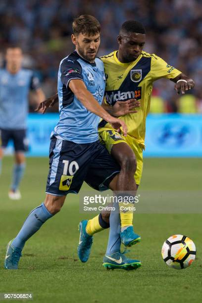 Milos Ninkovic of Sydney FC battles for the ball with Mariners Kwabena AppiahKubi during the round 17 ALeague match between Sydney FC and the Central...