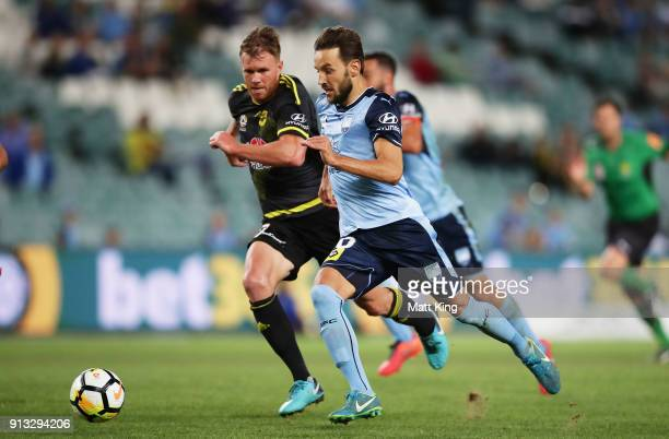 Milos Ninkovic of Sydney FC beats the defence to score a goal during the round 19 ALeague match between Sydney FC and the Wellington Phoenix at...