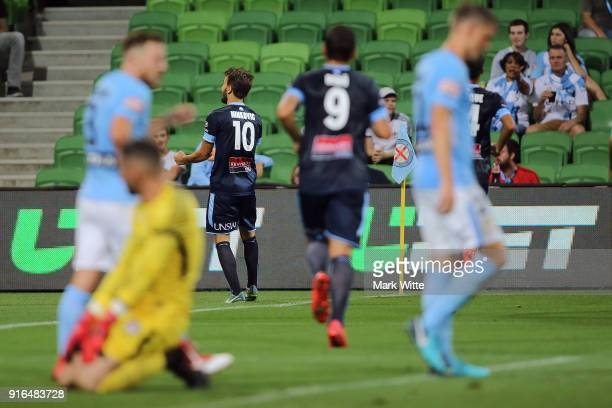 Milos Ninkovic of Sydney FC celebrates a goal infront of Dean Bouzanis of Melbourne City during the round 20 ALeague match between Melbourne City and...