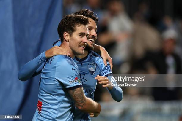Milos Ninkovic of Sydney FC celebrates kicking a goal with team mate Josh Brillante of Sydney FC during the A-League Semi Final match between Sydney...