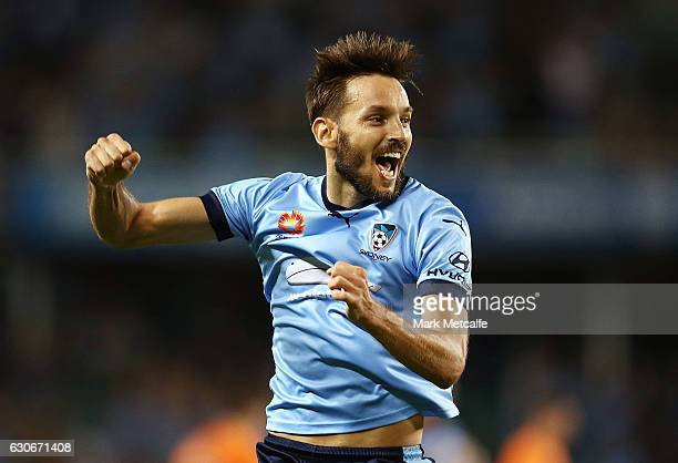 Milos Ninkovic of Sydney FC celebrates scoring a goal during the round 13 ALeague match between Sydney FC and Brisbane Roar at Allianz Stadium on...