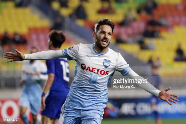 Milos Ninkovic of Sydney FC celebrates scoring the opening goal during the AFC Champions League Group H match between Suwon Samsung Bluewings and...