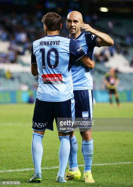 Milos Ninkovic of Sydney FC celebrates with Adrian Mierzejewski after scoring a goal during the round 19 ALeague match between Sydney FC and the...