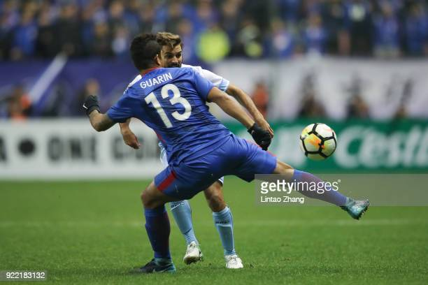 Milos Ninkovic of Sydney FC competes the ball Fredy Guarin of Shanghai Shenhua FC during the AFC Champions League Group H match between Shanghai...