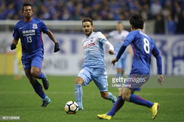 Milos Ninkovic of Sydney FC competes the ball with Zhang Lu of Shanghai Shenhua FC during the AFC Champions League Group H match between Shanghai...