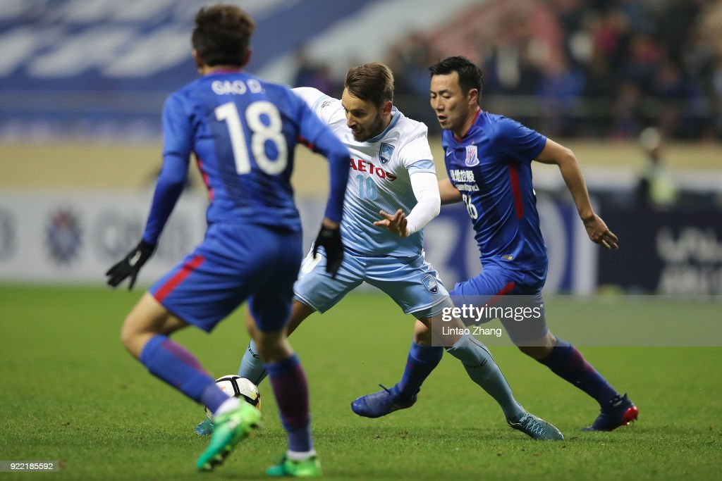 Milos Ninkovic of Sydney FC competes the ball with Zhang Lu of Shanghai Shenhua FC during the AFC Champions League Group H match between Shanghai Shenhua FC and Sydney FC at Hongkou Stadium on February 21, 2018 in Shanghai, China.