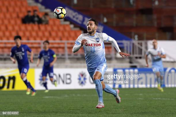 Milos Ninkovic of Sydney FC contros the ball to score the opening goal during the AFC Champions League Group H match between Suwon Samsung Bluewings...