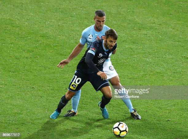 Milos Ninkovic of Sydney FC is challenged by Manny Muscat of the City during the round five ALeague match between Melbourne City FC and Sydney FC at...