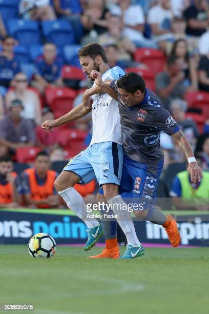 Milos Ninkovic of Sydney FC is contested by Dimitri Petratos of the Jets during the round 22 ALeague match between the Newcastle Jets and Sydney FC...