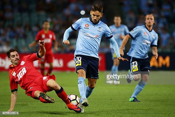 Milos Ninkovic of Sydney FC is tackled by Ben Garuccio of United during the round eight ALeague match between Sydney FC and Adelaide United at...
