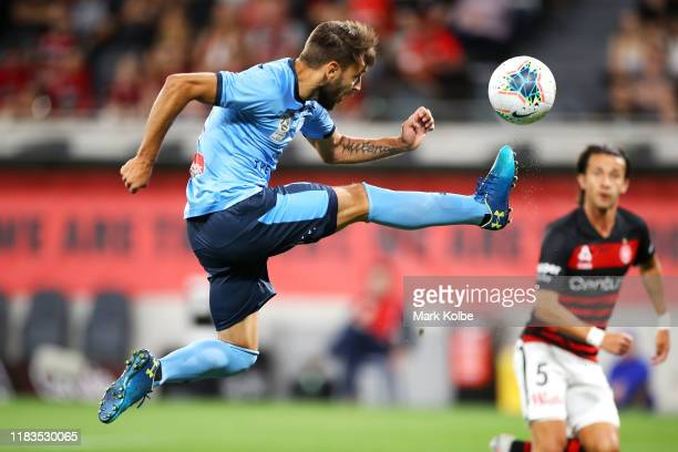 Milos Ninkovic of Sydney FC jumps to shoot at goal during the round three ALeague match between the Western Sydney Wanderers and Sydney FC at...