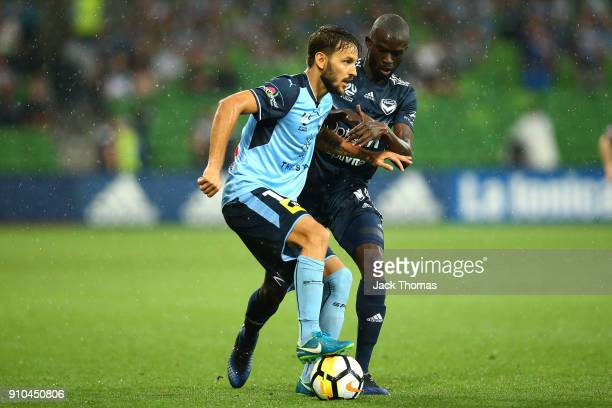 Milos Ninkovic of Sydney FC runs with the ball during the round 18 ALeague match between Melbourne Victory and Sydney FC at AAMI Park on January 26...