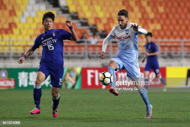 Milos Ninkovic of Sydney FC scores the opening goal during the AFC Champions League Group H match between Suwon Samsung Bluewings and Sydney FC at...
