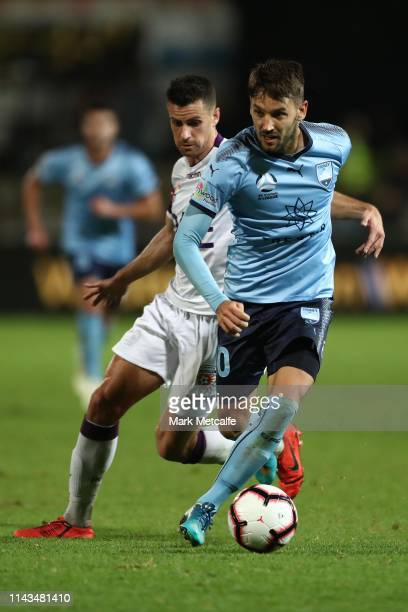 Milos Ninkovic of Sydney takes on Joel Chianese of the Glory during the round 26 ALeague match between Sydney FC and Perth Glory at Sydney Cricket...