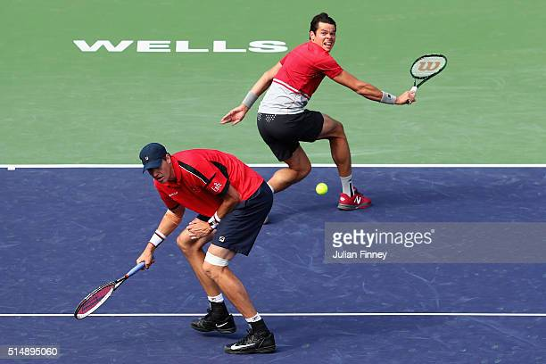 Milos Raonic of Canada and John Isner of USA in action against Andy Murray and Colin Fleming of Great Britain in the doubles during day five of the...