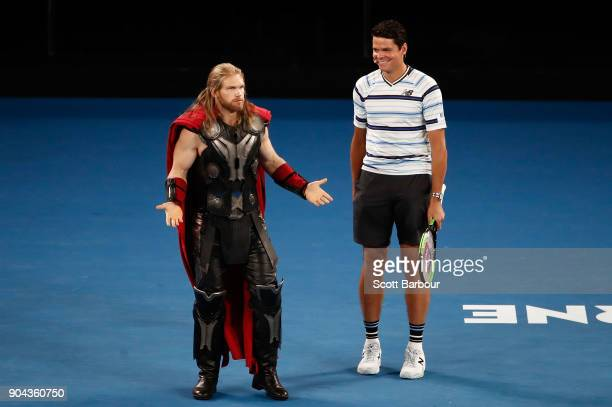 Milos Raonic of Canada and Thor talk at the sixth annual Kids Tennis Day ahead of the 2018 Australian Open at Melbourne Park on January 13 2018 in...