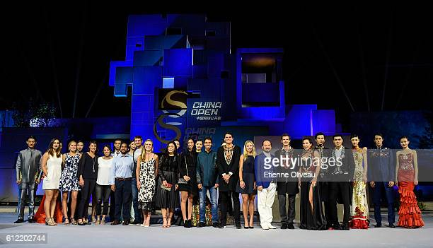 Milos Raonic of Canada Andy Murray of Scotland and Rafael Nadal of Spain Angelique Kerber of Germany pose for a group picture with other players...