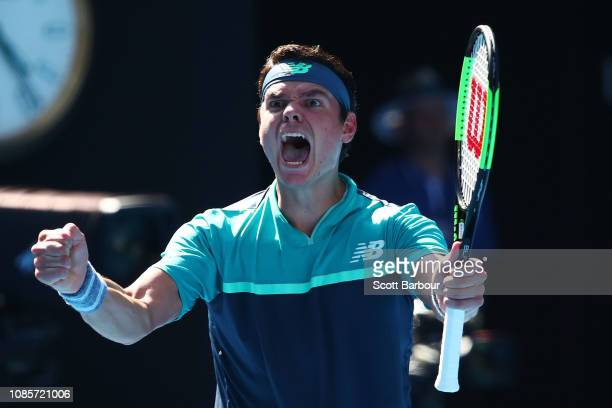 Milos Raonic of Canada celebrates after winning match point in his fourth round match against Alexander Zverev of Germany during day eight of the...