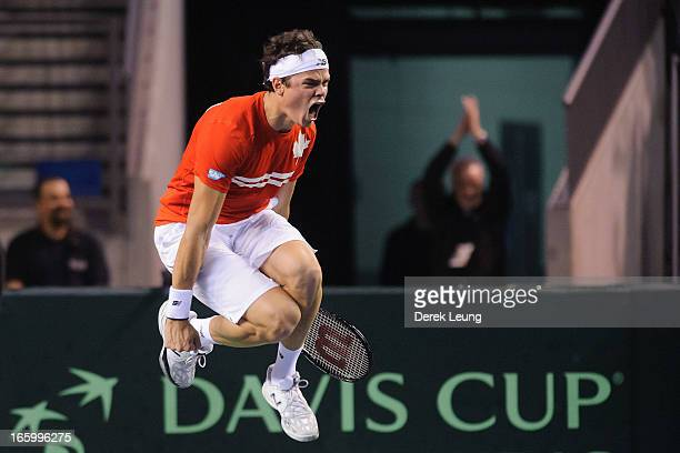 Milos Raonic of Canada celebrates his victory over Andreas Seppi of Italy during their singles match on day three of the 2013 Davis Cup quarterfinals...