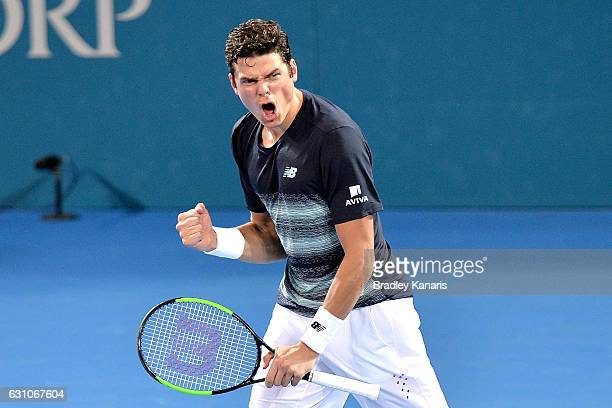 Milos Raonic of Canada celebrates victory after his match against Rafael Nadal of Spain on day six of the 2017 Brisbane International at Pat Rafter...
