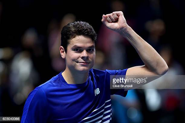 Milos Raonic of Canada celebrates victory in his men's singles match against Gael Monfils of France on day one of the ATP World Tour Finals at O2...