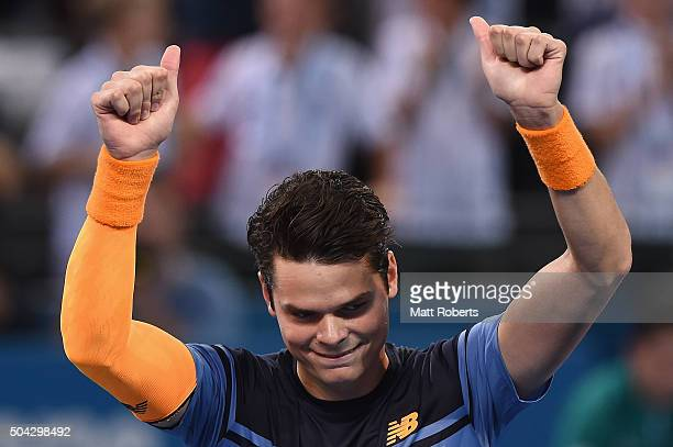 Milos Raonic of Canada celebrates winning the Mens Final against Roger Federer of Switzerland during day eight of the 2016 Brisbane International at...