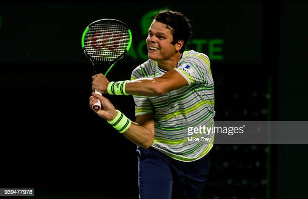Milos Raonic of Canada hits a backhand against Juan Martin Del Potro of Argentina during the quarterfinals match on Day 10 of the Miami Open...