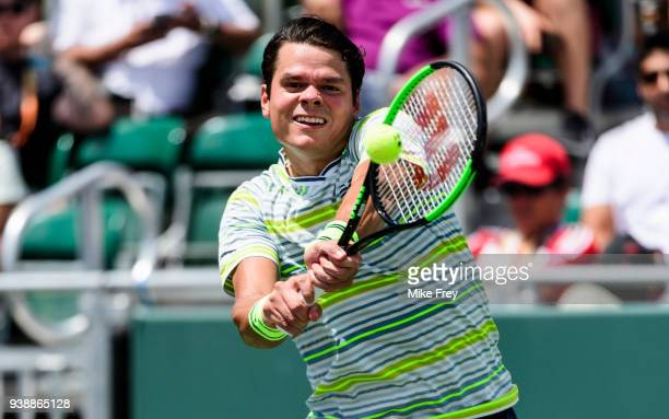 Milos Raonic of Canada hits a backhand to Jeremy Chardy of France during Day 9 of the Miami Open Presented by Itau at Crandon Park Tennis Center on...