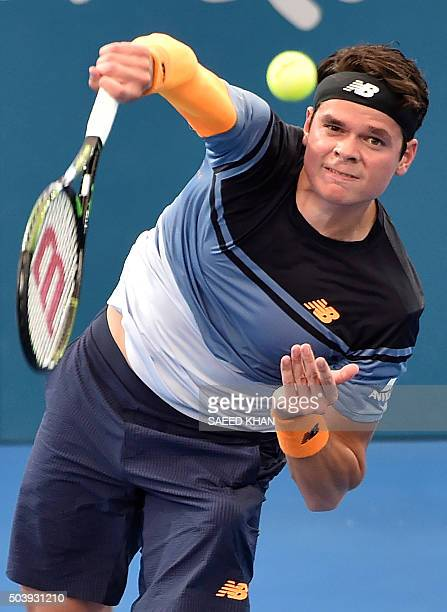 Milos Raonic of Canada hits a return against Lucas Pouille of France during their men's singles quarterfinal match on the sixth day of the Brisbane...
