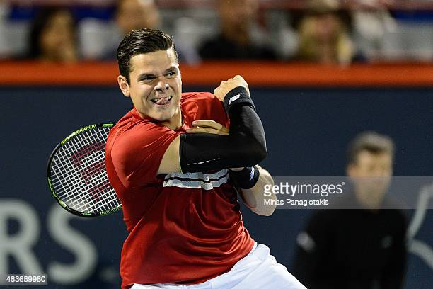 Milos Raonic of Canada hits the ball against Ivo Karlovic of Croatia during day two of the Rogers Cup at Uniprix Stadium on August 11 2015 in...