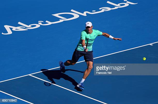 Milos Raonic of Canada in action against Andy Murray of Great Britain during the playoff match for third place of the Mubadala World Tennis...