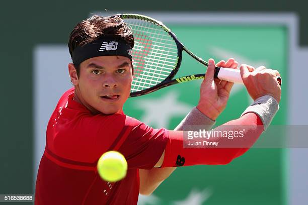 Milos Raonic of Canada in action against David Goffin of Belgium in the semi finals during day thirteen of the BNP Paribas Open at Indian Wells...