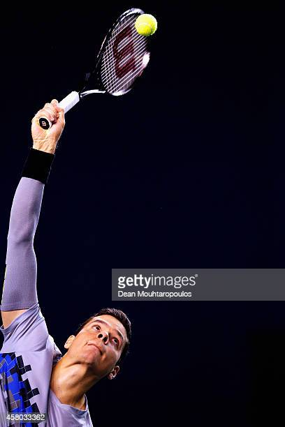 Milos Raonic of Canada in action against Jack Sock of the USA during day 3 of the BNP Paribas Masters held at the at Palais Omnisports de Bercy on...