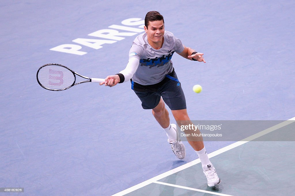 Milos Raonic of Canada in action against Roger Federer of Switzerland in their quarterfinal match during day 5 of the BNP Paribas Masters held at the at Palais Omnisports de Bercy on October 31, 2014 in Paris, France.