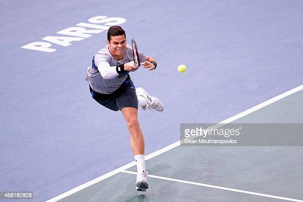 Milos Raonic of Canada in action against Roger Federer of Switzerland in their quarterfinal match during day 5 of the BNP Paribas Masters held at the...