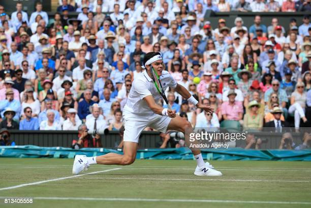 Milos Raonic of Canada in action against Roger Federer of Switzerland on day nine of the 2017 Wimbledon Championships at the All England Lawn and...