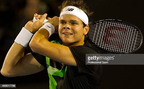 Milos Raonic of Canada in action during his fourth round match against Roger Federer of Switzerland on day eight of the 2013 Australian Open at...