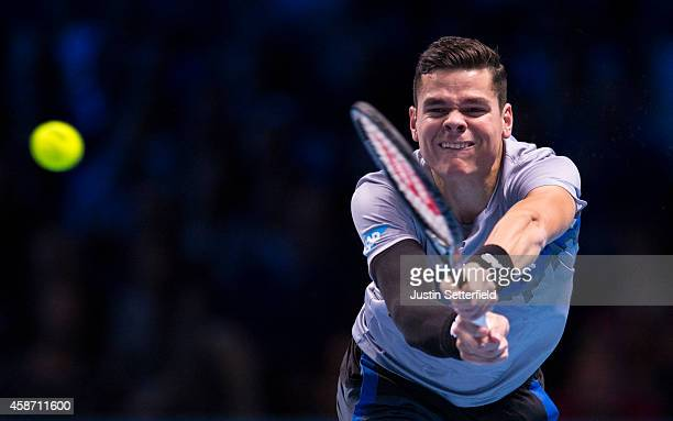 Milos Raonic of Canada in action in his match against Roger Federer of Switzerland in the round robin during day one of the Barclays ATP World Tour...