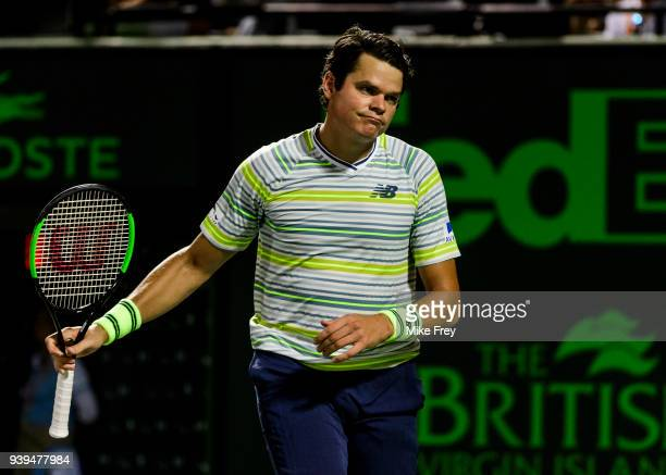 Milos Raonic of Canada looks dejected against Juan Martin Del Potro of Argentina during the quarterfinals match on Day 10 of the Miami Open Presented...