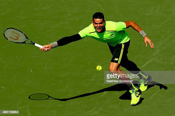 Milos Raonic of Canada lunges for a ball while playing Jeremy Chardy of France during day 8 of the Miami Open Presented by Itau at Crandon Park...