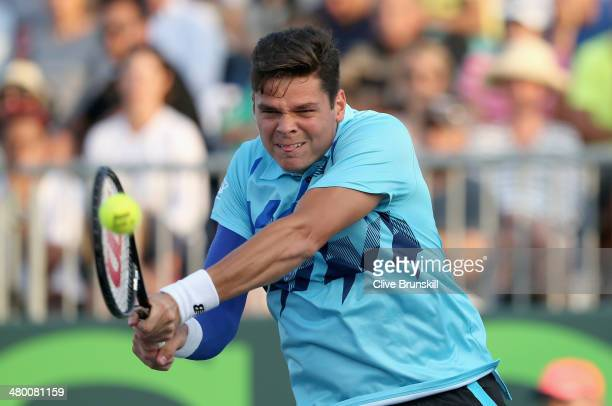 Milos Raonic of Canada plays a backhand against Jack Sock of the United States during their second round match during day 6 at the Sony Open at...