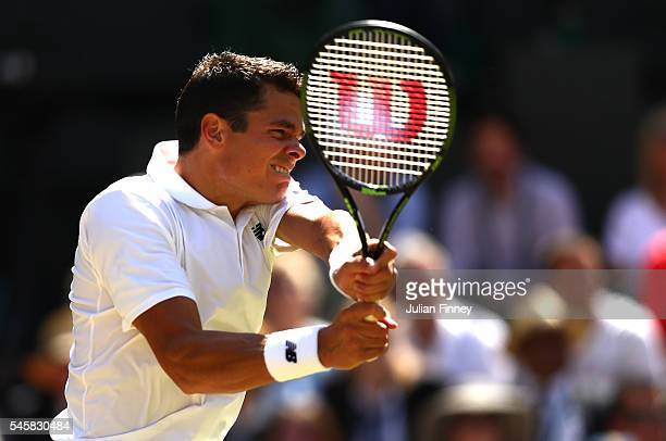 Milos Raonic of Canada plays a backhand during the Men's Singles Final against Andy Murray of Great Britain on day thirteen of the Wimbledon Lawn...
