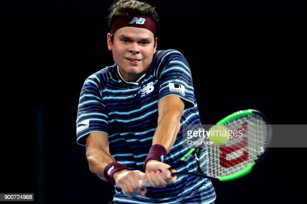 Milos Raonic of Canada plays a backhand in his match against Alex De Minaur of Australia during day four of the 2018 Brisbane International at Pat...