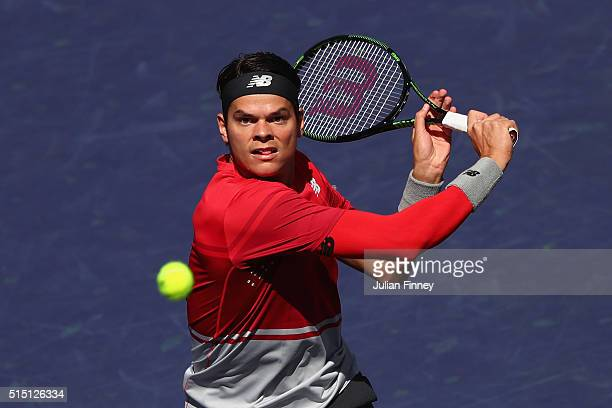 Milos Raonic of Canada plays a backhand in his match against Inigo Cervantes of Spain during day six of the BNP Paribas Open at Indian Wells Tennis...