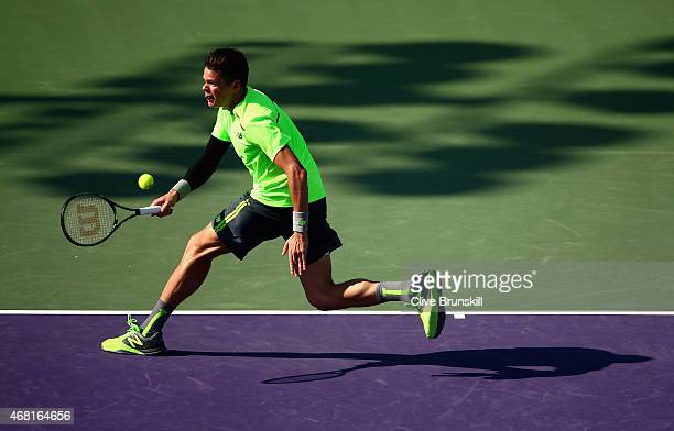 Milos Raonic of Canada plays a forehand against Jeremy Chardy of France in their third round match during the Miami Open Presented by Itau at Crandon...