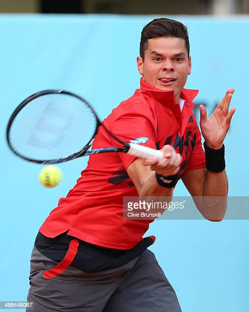 Milos Raonic of Canada plays a forehand against Jeremy Chardy of France in their second round match during day four of the Mutua Madrid Open tennis...