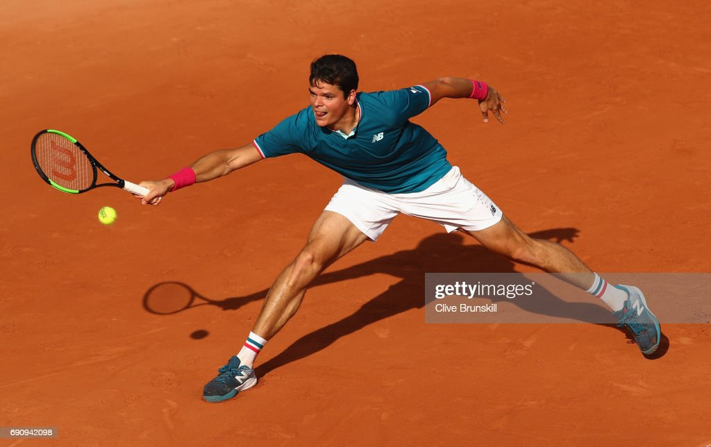 Milos Raonic of Canada plays a forehand during the mens singles second round match against Rogerio Dutra Silva of Brazil on day four of the 2017 French Open at Roland Garros on May 31, 2017 in Paris, France.