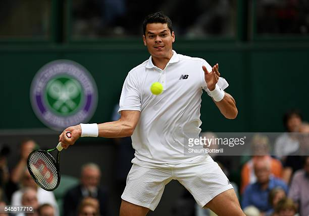 Milos Raonic of Canada plays a forehand during the Men's Singles Semi Final match against Roger Federer of Switzerland on day eleven of the Wimbledon...