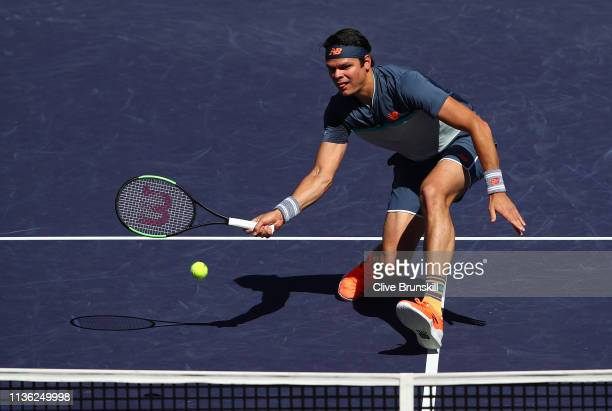 Milos Raonic of Canada plays a forehand volley against Dominic Thiem of Austria Milos Raonic of Canada during their men's singles semifinal match on...