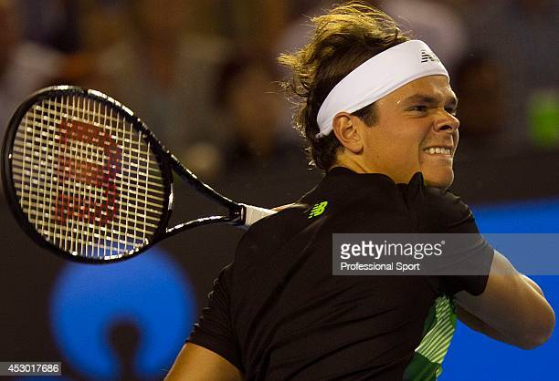 Milos Raonic of Canada plays a forehand volley in his fourth round match against Roger Federer of Switzerland during day eight of the 2013 Australian...